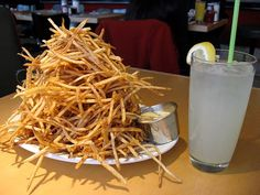 skinny fries - Skinny Fries are mentioned a few times in 52 Days The Cancer Journal. The Bing served these. They are thin or skinny french fries. Cancer Journal, Great Recipes, Favorite Recipes, French Fries, Coconut Flakes, Spices, Potatoes, Vegetarian, Yummy Food