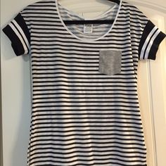 New Victoria Secret black & white striped tee Black and white striped tee. Grey pocket in the front. Loose, casual cotton soft fabric.Never worn! Victoria's Secret Tops Tees - Short Sleeve
