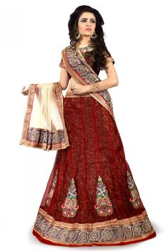 Net Party Wear Lehenga Choli In Maroon Colour.It comes with matching Dupatta and Choli.It is crafted with Resham Work,Zari Work,Stone Work,Mirror Work,Patch Work Design This Lehenga Choli can be Stitc...