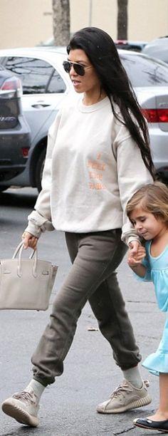 Who made  Kourtney Kardashian's white tote handbag, gray sneakers, and sweatshirt?