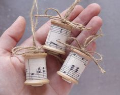 Sugared Spools - Collector's Delight Ornaments, made with Vintage Sheet Music, Wooden Thread Spools, and Twine. $9.50, via Etsy.