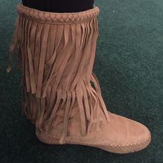 Moccasin boots Fringe boots. Braided top. Faux suede material. Gently used condition. You can only tell if your staring closely . Wild Diva Shoes Moccasins