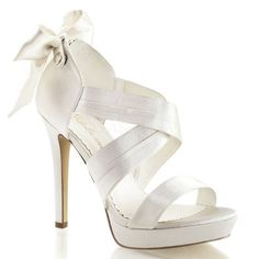 """4 3/4"""" Heel, 1"""" Platform Criss Cross Closed Back Sandals With Back Bow and Back Zipper."""