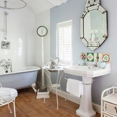 This country-style bathroom features vintage touches to create a pretty, feminine space. The feature tiles add an element of interest and personality