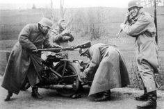 Well they think it's funny. German soldiers hamming for the camera during WWII.