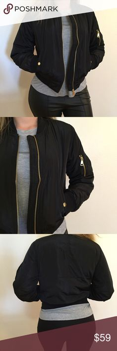 Black Padded Bomber Jacket Black Padded Bomber Jacket. Black with gold zipper detail. Side zip pockets. Available in S-M-L. True to size. Model is wearing a small for reference. Brand new. Never worn. NO TRADES. No offers will be considered unless made through the offer feature. Bundle 3+ items for 15% off. Thank you. Jackets & Coats