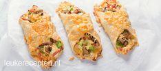 Snelle en makkelijke bladerdeeg snack gevuld met roomkaas, paprika, kaas en ham