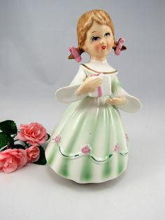 """Very Cute Vintage Schmid Bros. 1960's Ceramic Little Girl holding present """"Love Makes the World Go Round""""  Music Box. The Girl Spins around! by VintageQualityFinds on Etsy"""
