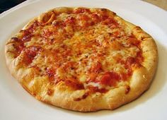Wolfgang Puck's Pizza Dough.    It is amazing how the same ingredients, combined in a different sequence, can taste so good.