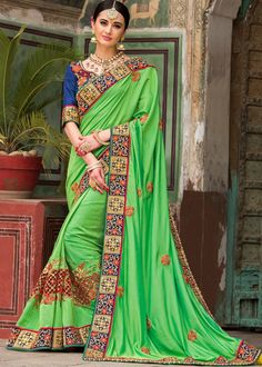 Embrace a #traditional look for #weddings adorning this #Green art #silk #saree.