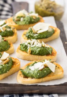 This Parmesan Spinach Dip Crostini is such a classy and unique appetizer to serve at your next party. Spinach Dip is loved by all, and now you don't need the chips to enjoy! Warm Parmesan Spinach Dip piled onto toasty French Bread is the ultimate in bruschetta recipes. This is one of our favorite game day or holiday recipes to make in a pinch.