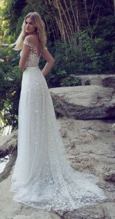 Bohemian chic embellished off-the-shoulder wedding dress; Featured Dress: Limor Rosen