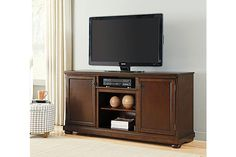 """The Porter 70"""" TV Stand from Ashley Furniture HomeStore (AFHS.com). With a rich rustic beauty radiating from the stylish details, the """"Porter"""" entertainment wall flawlessly transforms the atmosphere of any living room environment."""