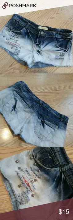 Distressed   denim shorts Pre owned,good condition, euro size 10 Measurement   waist  17 inches  Length 9 inches Shorts