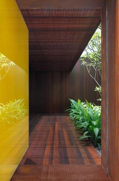 Lacquered Yellow and wood  AH House / Studio Guilherme Torres