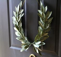 The Laurel Crest Wreath design has captivated our attention with its distinction for centuries. This classic wreath combines faux green laurel bay Laurel Leaves, Bay Leaves, Home Garden Design, Home And Garden, Holiday Wreaths, Holiday Decor, Christmas Decor, Laurel Wreath, Spring Green