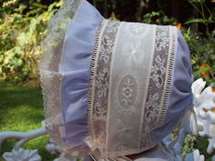 Bonnets aren't just cute, they protect babie's head from the hot summer sun ... using open-weave lace strips for the body of the bonnet allows air circulation. This is not handwork, you need a serger sewing machine for these decorative seams, but you could easily make one very similiar to this.