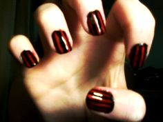 My red and black striped nails. - I've thought of this before but never tried it :P