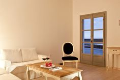 Thermes is simple yet chic, traditional yet luxurious with a sense of space, style and colorful ambience Luxury Villa, Villas, Floor Chair, Traditional, Architecture, Santorini, Simple, Wood, Interior