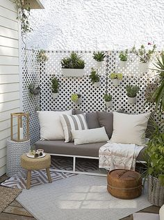 """The porch, just off the kitchen, has a hanging garden and plush seating. """"People love this spot,"""" Whitney says. """"It's connected to the house, but it still feels like a nook where you can have a one-on-one conversation."""""""