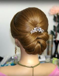 A bridal updo for medium to long hair. What do you think? #staceysbridal #bridalhairstyles