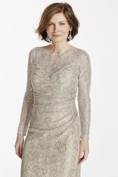 Floor Length allover metallic lace dress with Illusion long sleeves and sweetheart neckline. Designed by Emma Street. Fully lined. Back zip. Imported polyester. Professional dry clean only.