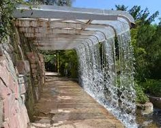 Fuente de agua con tinajas de aceite y luces fuente de for Cascadas de agua artificiales para jardin
