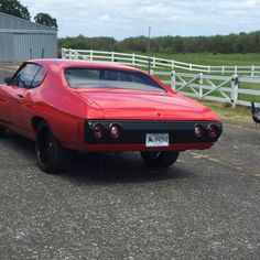 video clip of 72 chevelle red and black painted bumpers and trim .  mesh wheels pro touring