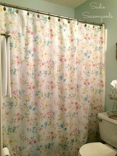 DIY a shower curtain from a vintage bed sheet