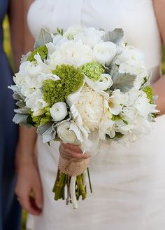 Standard white hydrangea , peonies, freesias, green mini hydrangea + ranunculus tied off with burlap. Swoon!