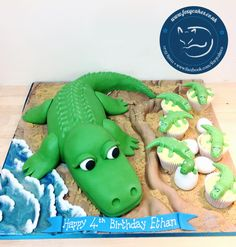 Crocodile cake with baby croc cupcakes, made by The Foxy Cake Co!