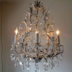 Large chandelier lighting distressed shabby French blue white accents vintage prisms and crystal garland ceiling fixture anita spero design