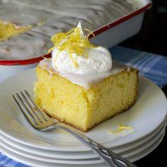Simple to make tart and sweet lemon cake with lemon glaze. Kept in the frig for a refreshing summer dessert.