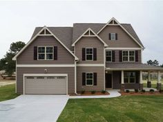 The BARTON Craftsman Plan in Mamie Belle Ridge with 4 BR 3 BA Foyer with Hardwoods Family Room with Gas Fireplace Master Suite wDual Vanities Large WIC Sep. Tub and Shower Large Open Kitchen with Pantry Granite Formal Living and Dining Rooms Guest Bedroom Downstairs Laundry Room Upstairs Large Loft Area Upstairs Another Beautiful Savvy Built Home SHLLC.