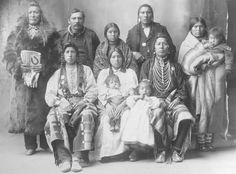 Rhinehart photo of Piegans, 1898 (?). Standing at the left is Mountain Chief.