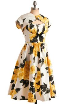 So Fifties! One thing I'd change is the print, not diggin those flowers.