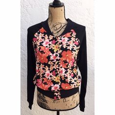 Blu Moon Floral Print Long Sleeved Bomber Jacket Blu Moon Floral Print Bomber with Black Contrasting Long Sleeves, Ribbed Hemline & Collar. Bold Red, Pink, Orange & Yellow Colors create the gorgeous Floral Pattern made of Chiffon Fabric. Black Contrast Cotton Panels. Front Silver Button Snap Closures. Two Front Side Slit Pockets. Size Small, Brand New Never Worn. Blu Moon Jackets & Coats