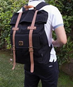 e5e647536e2e Man wearing Roll top vintage rucksack backpack by Serbags Canvas Backpacks