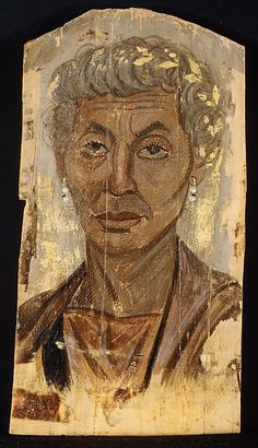 Portrait of an elderly lady with a gold wreath Period: Roman Period Date: A.D. 100–125 Geography: From Egypt Medium: Encaustic, limewood Dimensions: H. 34 x W. 18.4 cm (13 3/8 x 7 1/4 in.) Credit Line: Rogers Fund, 1909 Accession Number: 09.181.5
