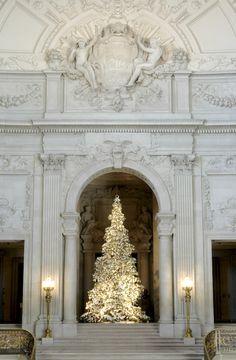 Wish-filled origami cranes adorn a Christmas tree at San Francisco City Hall.