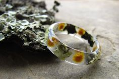 This resin ring is designed and inspired in natural live. Is made with high…