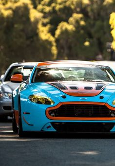 Unbelievably Cool Aston Martin Vantage V12 Gulf. Click on the pic and you can win the ultimate #AstonMartin driving experience!