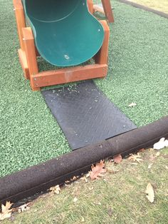 Rubber mats added at the base of slides and under swings will add extra cushion and help keep the loose rubber mulch from scattering.#green #mats #slides #playgrounds #rubbermats #rubbermulch #rubberboarders #RoosterRubber