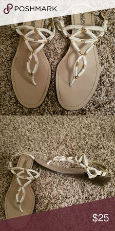 Carlos Santana Wedge Sandals Small wedge heel with white and gold straps. Buckle closure on heel. Like new condition. Carlos Santana Shoes Sandals
