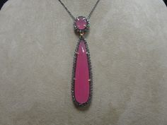 Raw diamond and ruby pendant in yellow gold with black rhodium. Available at www.yanina-co.com, 800-780-3433.