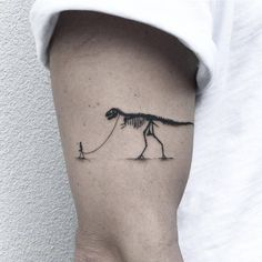 Walking the T-Rex tattoo on the right upper arm.