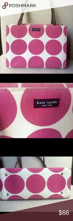 """Authentic vintage kate spade pink polka dot bag Cute and sturdy kate spade cotton canvas bag with big dark pink polka dots! . Has nubs on the bottom so it stands alone. Faint yellow stain on one of the sides as seen in pic, and faded from age, otherwise in great condition. Size 11 x 8 x 5"""", strap brown leather and cloth-10.5"""" drop. kate spade Bags Shoulder Bags"""