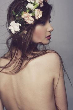 Topless model in the studio with flowers (implied nude) and used as a wreath. Emily N - possible
