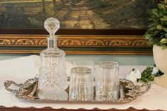 This is a beautiful bar serving set. Theodore Starr Silver Plate Tray; Crystal Decanter with silver plate collar and a set of high ball glasses.