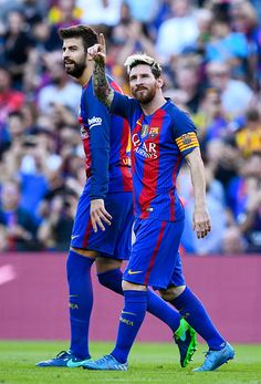 Lionel Messi of FC Barcelona celebrates with his team mate Gerard Pique after scoring his team's fourth goal during the La Liga match between FC...